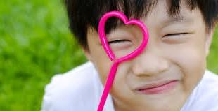 boy with heart lollipop